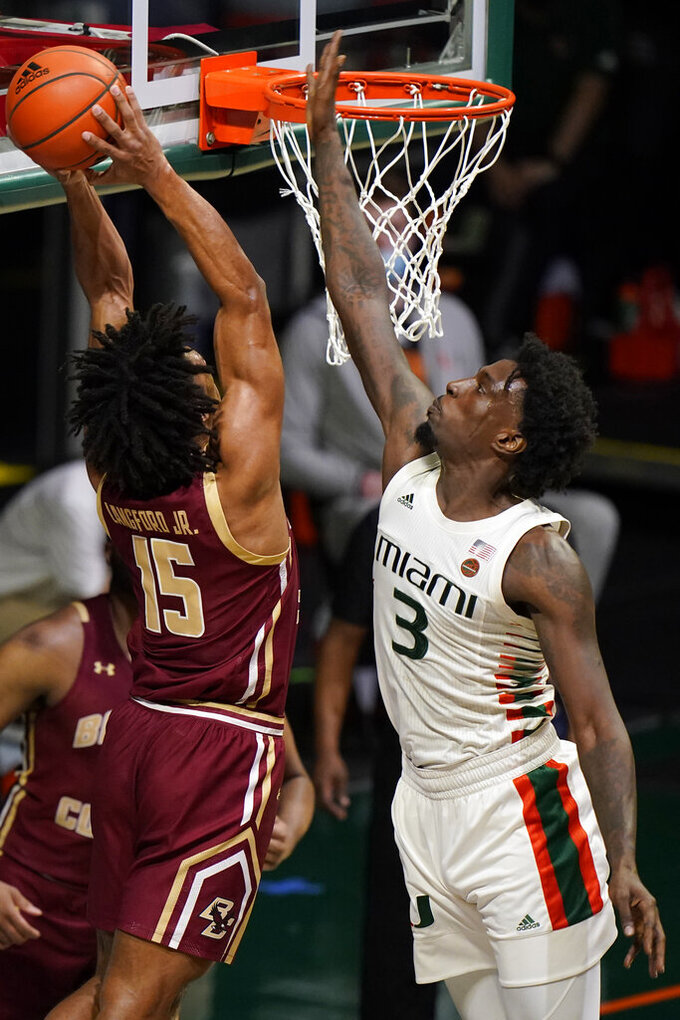 Boston College guard DeMarr Langford Jr. (15) attempts a dunk against Miami center Nysier Brooks (3) during the first half of an NCAA college basketball game, Friday, March 5, 2021, in Coral Gables, Fla. (AP Photo/Wilfredo Lee)