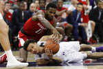 Nebraska guard Dachon Burke Jr., top, and Northwestern forward A.J. Turner battle for the ball during the first half of an NCAA college basketball game in Evanston, Ill., Saturday, Jan. 11, 2020. (AP Photo/Nam Y. Huh)