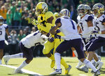 Oregon wide receiver Dillon Mitchell (13), crosses the goal line in the first quarter against Washington during an NCAA college football game in Eugene, Ore., Saturday, Oct. 13, 2018. (AP Photo/Thomas Boyd)