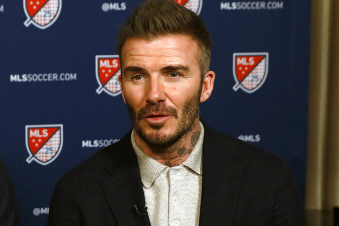 FILE - Inter Miami CF co-owner David Beckham is interviewed during the Major League Soccer 25th Season kickoff event in New York, in this Wednesday, Feb. 26, 2020, file photo. Major League Soccer announced Friday, March 5, 2021, that it is investigating whether David Beckham's Inter Miami violated salary budget and roster guidelines by its signing of French midfielder Blaise Matuidi.(AP Photo/Richard Drew, File)