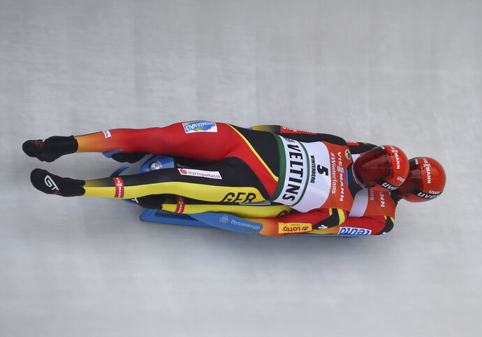 Toni Eggert, left and Sascha Benecken from Germany in action during the men's luge World Championships in Winterberg, Germany, Saturday, Jan.26, 2019. (Caroline Seidel/dpa via AP)