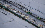 Cars are stuck on the snowy Tohoku Expressway in Osaki city, Miyagi prefecture, northern Japan, after a multiple car accident, Tuesday, Jan. 19. 2021. (Yuta Omori/Kyodo News via AP)