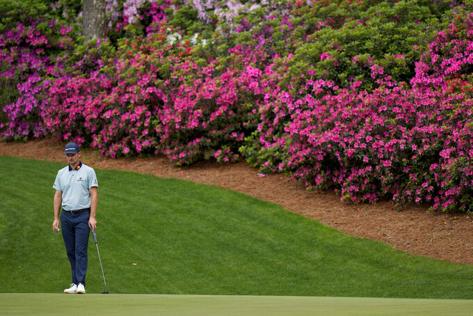 Justin Rose, of England, waits to putt on the 13th hole during the second round of the Masters golf tournament on Friday, April 9, 2021, in Augusta, Ga. (AP Photo/David J. Phillip)