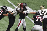 New Orleans Saints defensive end Carl Granderson (96) knocks the ball out for a turnover as he hits Atlanta Falcons quarterback Matt Ryan during the fourth quarter of an NFL football game Sunday, Dec. 6, 2020, in Atlanta. (Curtis Compton/Atlanta Journal-Constitution via AP)
