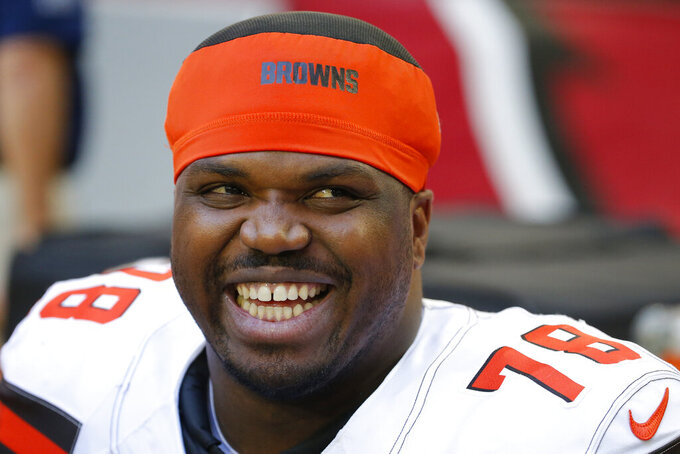 FILE - In this Dec. 15, 2019, file photo, Cleveland Browns offensive tackle Greg Robinson smiles during an NFL football game against the Arizona Cardinals in Glendale, Ariz. Robinson was being held Wednesday, Feb. 19, 2020,  in a Texas jail on a pending drug distribution charge from a federal agency, records show. Robinson, 27, was booked Tuesday, according to El Paso County jail records.(AP Photo/Rick Scuteri, File)