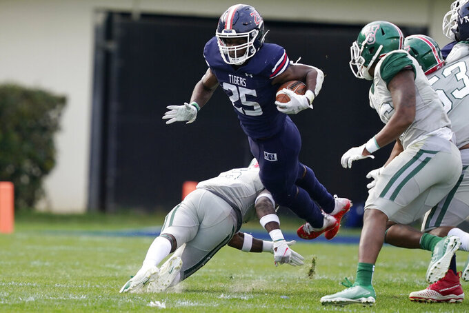 Jackson State running back Tyson Alexander (25) is knocked into the air by a Mississippi Valley State defender during the second half of an NCAA college football game, Sunday, March 14, 2021, in Jackson, Miss. (AP Photo/Rogelio V. Solis)