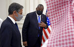 US Secretary of State Antony Blinken, foreground and Secretary of Defense Lloyd Austin, arrive for a joint press conference, at the Ministry of Foreign Affairs in Doha, Qatar, Tuesday, Sept. 7, 2021. (Olivier Douliery/Pool Photo via AP)