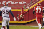 Kansas City Chiefs wide receiver Tyreek Hill (10) does a back flip into the end zone against the Denver Broncos in the second half of an NFL football game in Kansas City, Mo., Sunday, Dec. 6, 2020. The 48-yard scoring play was nullified by an offensive holding penalty. (AP Photo/Charlie Riedel)