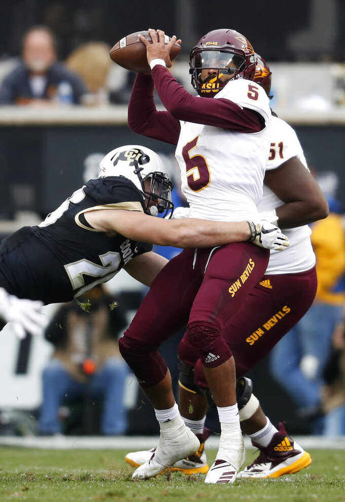Colorado linebacker Carson Wells, left, hits Arizona State quarterback Manny Wilkins as he throws a pass in the second half of an NCAA college football game Saturday, Oct. 6, 2018, in Boulder, Colo. Colorado won 28-21. (AP Photo/David Zalubowski)