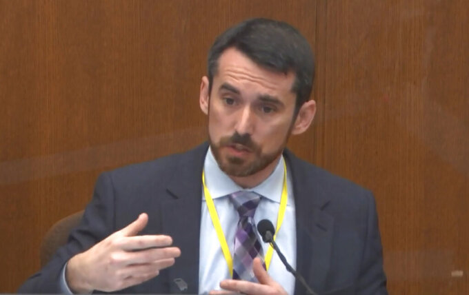 In this image from video, Seth Stoughton, testifies as Hennepin County Judge PeterCahill presides over court Monday, April 12, 2021, in the trial of former Minneapolis police Officer Derek Chauvin, in the May 25, 2020, death of George Floyd at the Hennepin County Courthouse in Minneapolis, Minn. (Court TV via AP, Pool)