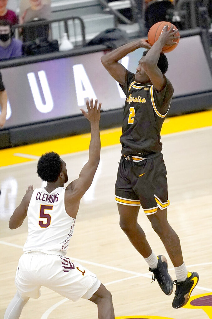 Valparaiso's Zion Morgan (2) shoots over Loyola Chicago's Keith Clemons during the first half of an NCAA college basketball game Wednesday, Feb. 17, 2021, in Chicago. (AP Photo/Charles Rex Arbogast)