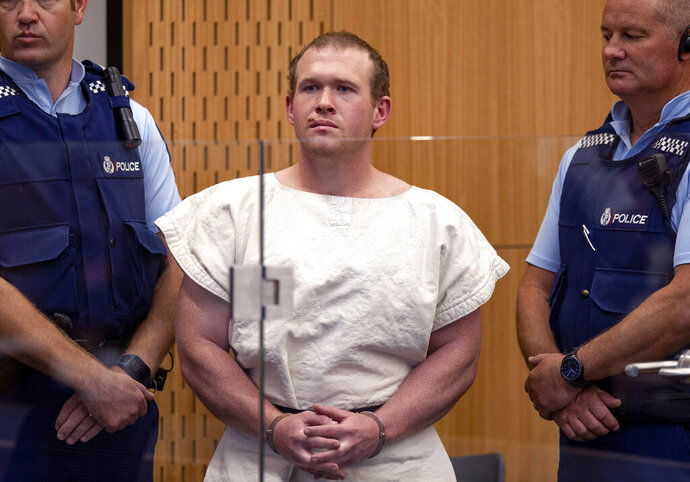 FILE - In this Saturday, March 16, 2019, file photo, Brenton Tarrant, the man charged in relation to the Christchurch mosque shootings, appears in the Christchurch District Court, in Christchurch, New Zealand. One year after killing 51 worshipers at two Christchurch mosques, Tarrant, an Australian white supremacist accused of the slaughter on Thursday, March 26, 2020, changed his plea to guilty. (Mark Mitchell/Pool via AP, File)