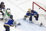 St. Louis Blues goalie Jake Allen (34) makes the save on Dallas Stars' Corey Perry (10) during the second period of an NHL qualifying round game in Edmonton, Alberta on Sunday, Aug. 9, 2020. (Jason Franson/The Canadian Press via AP)
