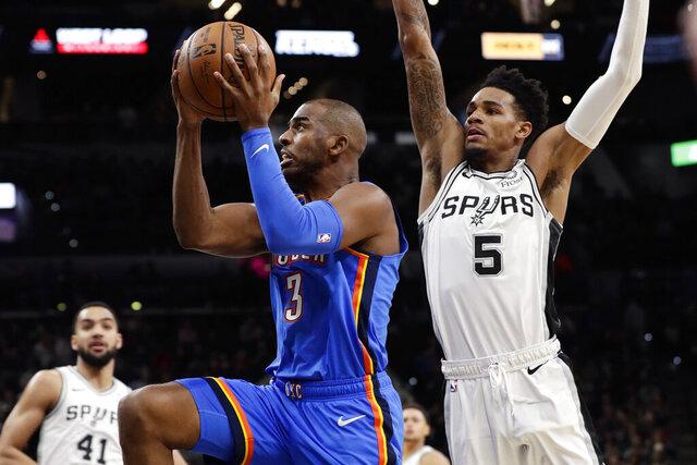 Oklahoma City Thunder guard Chris Paul (3) drives past San Antonio Spurs guard Dejounte Murray (5) during the first half of an NBA basketball game, in San Antonio, Thursday, Jan. 2, 2020. (AP Photo/Eric Gay)