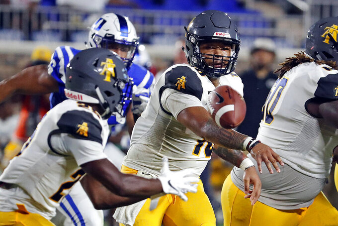 North Carolina A&T's Kylil Carter (10) pitches the ball to Kashon Baker (25) during the second half of an NCAA college football game against the Duke in Durham, N.C., Saturday, Sept. 7, 2019. (AP Photo/Karl B DeBlaker)