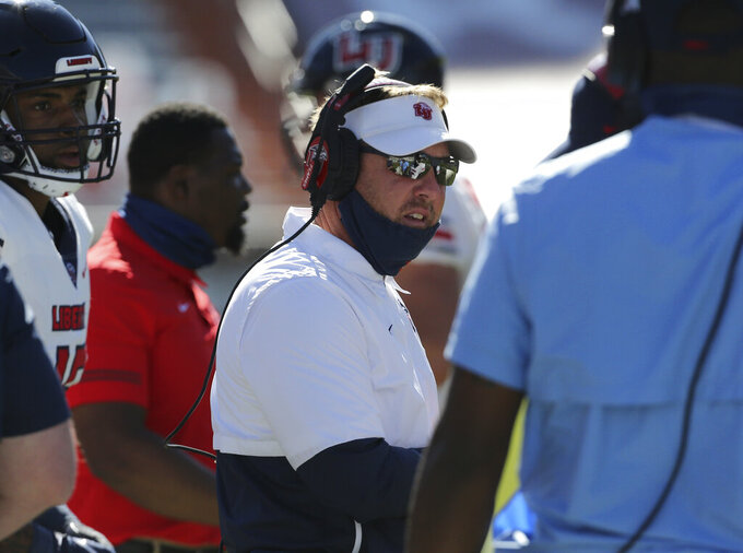 Liberty head coach Hugh Freeze stands on the sideline during the first half of an NCAA college football game against Virginia Tech, Saturday, Nov. 7 2020, in Blacksburg, Va. (Matt Gentry/The Roanoke Times via AP, Pool)