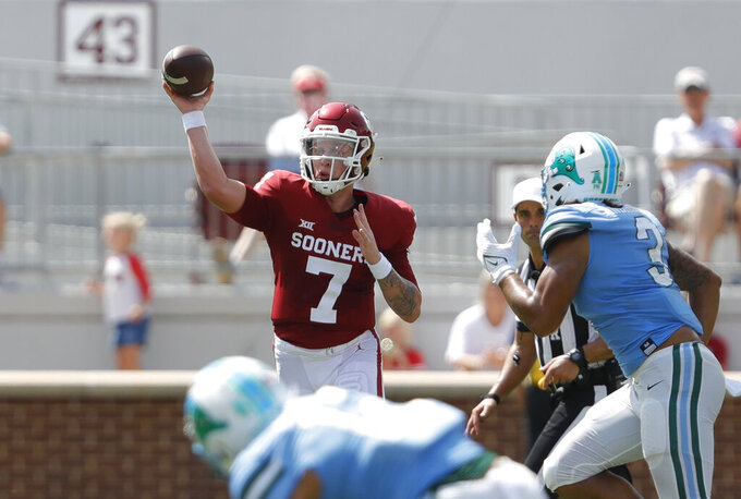 Oklahoma quarterback Spencer Rattler (7) passes the ball against Tulane during a NCAA college football game Saturday, Sept. 4, 2021, in Norman, Okla. (AP Photo/Alonzo Adams)