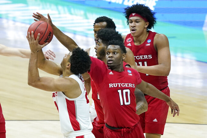 Rutgers' Montez Mathis (10) defends against Houston's Quentin Grimes, left, during the first half of a college basketball game in the second round of the NCAA tournament at Lucas Oil Stadium in Indianapolis Sunday, March 21, 2021. (AP Photo/Mark Humphrey)
