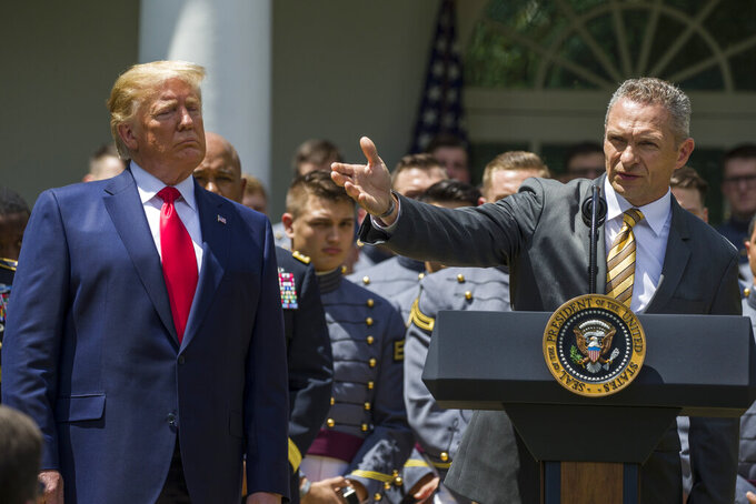 President Donald Trump, watches as Army head football coach Jeff Monken speaks during the presentation of the Commander-in-Chief's Trophy to the U.S. Military Academy at West Point football team, in the Rose Garden of the White House, Monday, May 6, 2019, in Washington. (AP Photo/Alex Brandon)