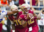 Florida defensive lineman Jabari Zuniga (92) gets a hand on Florida State quarterback Deondre Francois (12) in the 1st half of an NCAA college football game in Tallahassee, Fla., Saturday, Nov. 24, 2018. (AP Photo/Mark Wallheiser)
