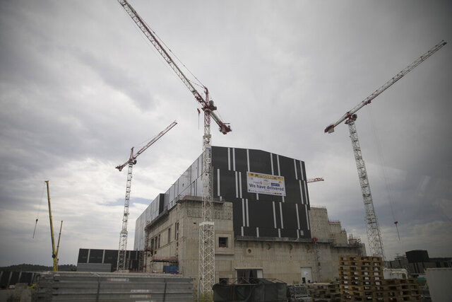 Assembly hall at the construction site of the ITER ( the International Thermonuclear Experimental Reactor), where components for the ITER Tokamak will be pre-assembled before integration into the machine in the CEN of Cadarache, in Saint-Paul-Lez-Durance, southern France, Tuesday, July 28, 2020. A project of daunting proportions and giant ambitions replicating the energy of the sun is entering a critical phase as scientists and technicians begin piecing together massive parts built around the globe of a nuclear fusion device, an experiment aimed at showing that clean energy, free of carbon emissions, can keep our planet humming. (AP Photo/Daniel Cole)