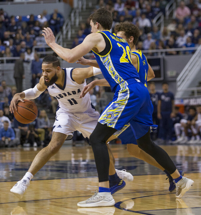 Nevada forward Cody Martin (11) drives against San Jose State forward Noah Baumann (20) during the first half of an NCAA college basketball game in Reno, Nev., Wednesday, Jan. 9, 2019. (AP Photo/Tom R. Smedes)