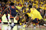 Illinois guard Ayo Dosunmu, bottom, dives for a lose ball as Maryland forward Makhi Mitchell (21) challenges him for it during the first half of an NCAA college basketball game, Saturday, Dec. 7, 2019, in College Park, Md. Also seen are Illinois' Andres Feliz (10) and Kipper Nichols (2) and Maryland's Darryl Morsell, back. (AP Photo/Julio Cortez)