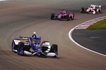 Alex Palou (10) drives during an IndyCar auto race at World Wide Technology Raceway on Saturday, Aug. 21, 2021, in Madison, Ill. (AP Photo/Jeff Roberson)