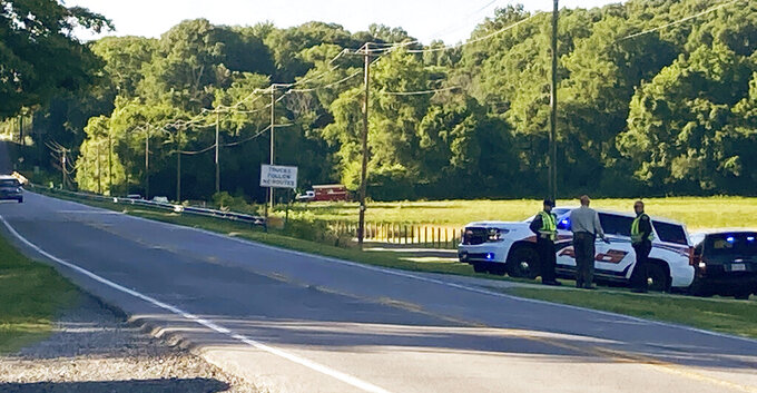 Rockingham County Sheriff Sam Page waits with other officials for the arrival of the State Highway Patrol's helicopter, equipped with infrared technology, to aid in the search for a group of missing rafters on Thursday evening, June 17, 2021, in Eden, N.C. Local officials in North Carolina say the body of a fourth tuber has been found in a river following a deadly accident in which a family on a recreational float went over a dam. One tuber now remains missing Sunday, June 21, following Wednesday night's accident that involved nine people.  (Susan Spear/News & Record via AP)