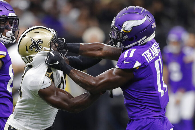 Minnesota Vikings wide receiver Laquon Treadwell (11) and New Orleans Saints defensive back Chris Banjo get into a scuffle in the first half of an NFL preseason football game in New Orleans, Friday, Aug. 9, 2019. (AP Photo/Bill Feig)