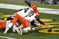Cleveland Browns strong safety Karl Joseph (42) recovers a fumbled in the end zone for a touchdown during the first half of an NFL wild-card playoff football game against the Pittsburgh Steelers in Pittsburgh, Sunday, Jan. 10, 2021.(AP Photo/Don Wright)