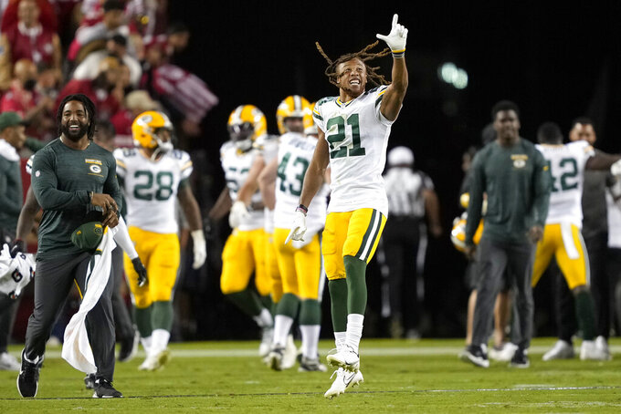 Green Bay Packers cornerback Eric Stokes (21) and teammates celebrate after the Packers defeated the San Francisco 49ers in an NFL football game in Santa Clara, Calif., Sunday, Sept. 26, 2021. (AP Photo/Tony Avelar)