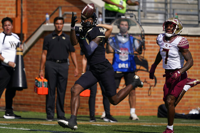 Wake Forest wide receiver A.T. Perry, left, catches a touchdown pass ahead of Florida State defensive back Jarrian Jones during the first half of an NCAA college football game Saturday, Sept. 18, 2021, in Winston-Salem, N.C. (AP Photo/Chris Carlson)