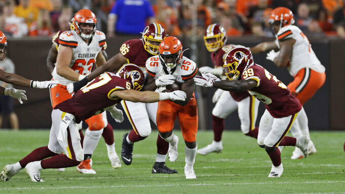 Cleveland Browns running back Dontrell Hilliard (25) rushes during the first half of the team's NFL preseason football game against the Washington Redskins, Thursday, Aug. 8, 2019, in Cleveland. (AP Photo/Ron Schwane)