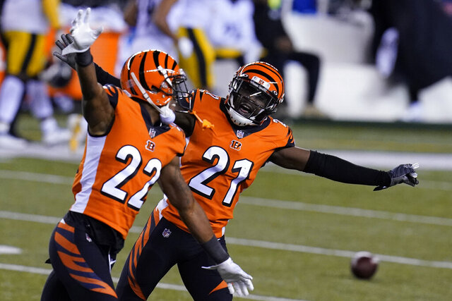 Cincinnati Bengals' Mackensie Alexander (21) and William Jackson (22) celebrate after Pittsburgh Steelers turned the ball over on downs during the second half of an NFL football game, Monday, Dec. 21, 2020, in Cincinnati. (AP Photo/Michael Conroy)