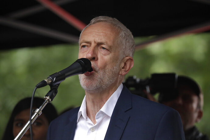 """FILE - In this Tuesday, June 4, 2019 file photo, the leader of Britain's opposition Labour party Jeremy Corbyn makes a speech on stage during a rally, as people gathered on Whitehall in London, demonstrating against the state visit of President Donald Trump. More than 60 Labour Party members of Britain's House of Lords have taken out a newspaper advertisement accusing leader Jeremy Corbyn of overseeing a """"toxic culture"""" by allowing anti-Semitism to fester in the party. The full-page ad in the Guardian newspaper accuses Corbyn of """"allowing anti-Semitism to grow in our party and presiding over the most shaming period in Labour's history."""" (AP Photo/Matt Dunham, File)"""