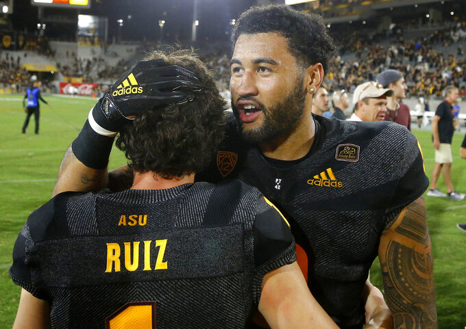 Arizona State place kicker Brandon Ruiz (1) celebrates his game-winning field goal against Michigan State with Arizona State linebacker Jay Jay Wilson, right, after an NCAA college football game Saturday, Sept. 8, 2018, in Tempe, Ariz. Arizona State defeated Michigan State 16-13. (AP Photo/Ross D. Franklin)
