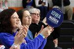 People applaud at a town hall meeting as they wait for Democratic presidential candidate Sen. Elizabeth Warren, D-Mass., to speak Sunday, Jan. 26, 2020, in Davenport, Iowa. (AP Photo/Sue Ogrocki)