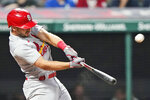 St. Louis Cardinals' Paul DeJong hits a two-run home run during the seventh inning of the team's baseball game against the Cleveland Indians, Tuesday, July 27, 2021, in Cleveland. (AP Photo/Tony Dejak)
