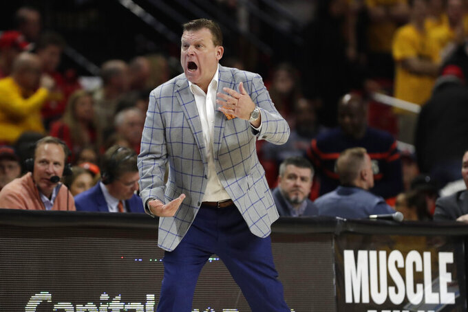 Illinois head coach Brad Underwood reacts during the first half of an NCAA college basketball game against Maryland, Saturday, Dec. 7, 2019, in College Park, Md. (AP Photo/Julio Cortez)