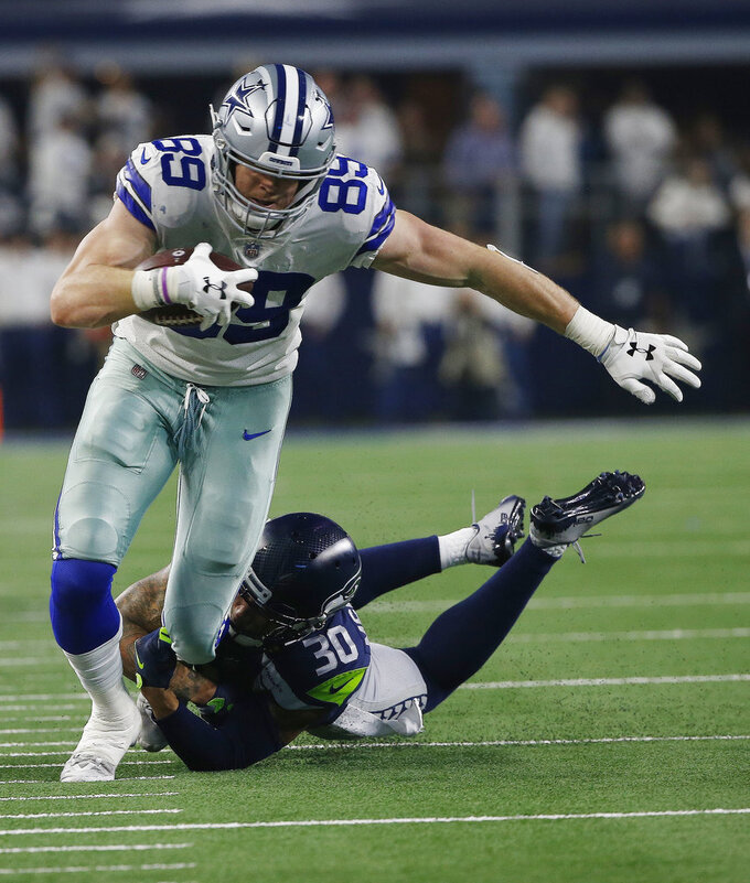 Seattle Seahawks strong safety Bradley McDougald (30) tackles Dallas Cowboys tight end Blake Jarwin (89) during the first half of the NFC wild-card NFL football game in Arlington, Texas, Saturday, Jan. 5, 2019. (AP Photo/Ron Jenkins)