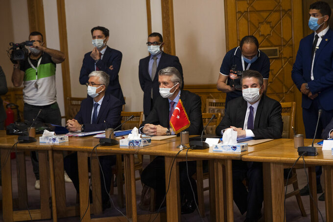 Turkish Foreign Ministry Deputy Sedat Onal, seated right, meets with Hamdi Sanad Loza, Egyptian deputy foreign minister along with their delegations, at the foreign ministry in Cairo, Egypt, Wednesday, May 5, 2021. (AP Photo/Nariman El-Mofty)