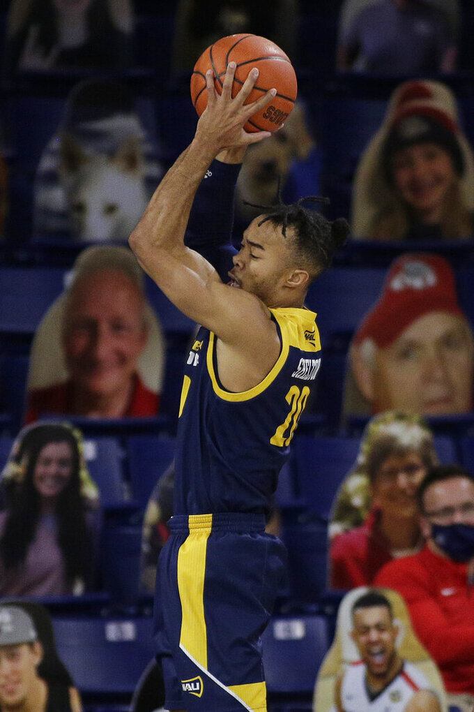 Northern Arizona guard Cameron Shelton grabs a rebound during the second half of the team's NCAA college basketball game against Gonzaga in Spokane, Wash., Monday, Dec. 28, 2020. Gonzaga won 88-58. (AP Photo/Young Kwak)