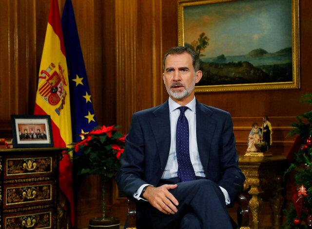 In this photo released on Tuesday Dec. 24, 2019, Spain's King Felipe VI delivers his traditional annual Christmas speech from the Zarzuela Palace in Madrid, Spain. (Ballesteros, Pool photo via AP)