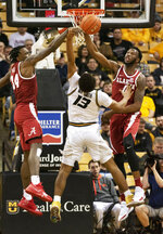 Missouri's Mark Smith, center, has his shot blocked by Alabama's Donta Hall, right, and Tevin Mack during the second half of an NCAA college basketball game, Wednesday, Jan. 16, 2019, in Columbia, Mo. Alabama won 70-60. (AP Photo/L.G. Patterson)