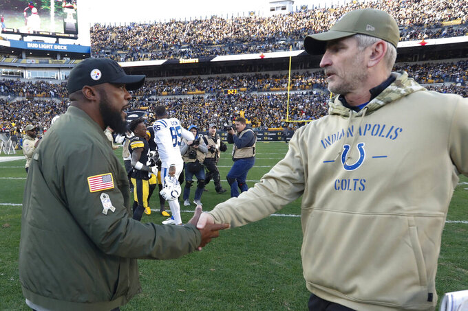 Pittsburgh Steelers head coach Mike Tomlin, left, greets Indianapolis Colts head coach Frank Reich after an NFL football game Sunday, Nov. 3, 2019, in Pittsburgh. (AP Photo/Don Wright)