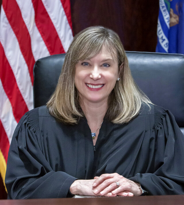 Michigan Supreme Court Justice Elizabeth Welch poses for a photo in the Supreme Court Chambers in Lansing, Mich., on Dec. 29, 2020. Justice Welch made her public debut Wednesday, Jan. 6, 2021, as the Michigan Supreme Court heard arguments in five cases.  (Dave Trumpie via AP)