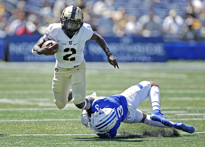Army quarterback Tyhier Tyler (2) is tackled by Georgia State's Chris Bacon (3) during the first half of an NCAA football game Saturday, Sept. 4, 2021, in Atlanta. (AP Photo/Ben Margot)
