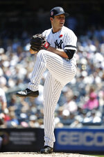 New York Yankees relief pitcher David Hale winds up against the San Diego Padres during the second inning of a baseball game, Monday, May 27, 2019, in New York. (AP Photo/Michael Owens)