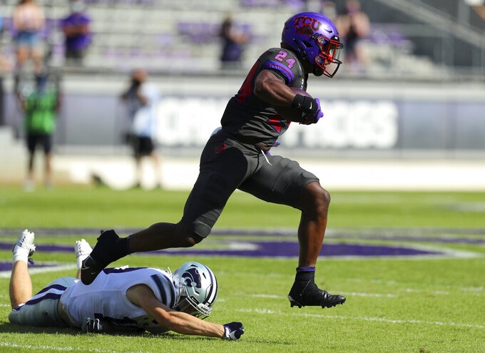 TCU running back Darwin Barlow (24) breaks away from a Kansas State defender on a run in the first quarter of an NCAA college football game Saturday, Oct. 10, 2020, in Fort Worth, Texas. (AP Photo/Richard W. Rodriguez)
